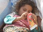 Desperate: Displaced Yazidis are clawing for food and drink to stay alive in the desert, with children allegedly drinking their parents' blood