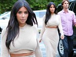 Wardrobe malfunction? Kim Kardashian exposes midriff in oddly cropped top during outing in the Hamptons having taken the scissors to a perfectly good dress