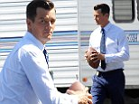 Josh Duhamel teaches a friend how to throw a football during a break on the set of his new show Battle Creek filming in Pasadena, California