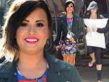 She's glam rock! Demi Lovato shows off her edge in leather jacket and printed dress after disguising herself behind a pillow and hoodie