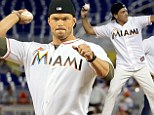 It takes two! Kellan Lutz and Antonio Banderas join forces to throw ceremonial first pitch at Miami Marlins game