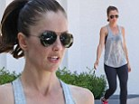If you've got them, flaunt them! Minka Kelly steps out with noticeable sweat patches after grueling gym session