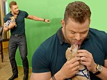 Kellan Lutz appeared on Spanish-language morning show Despierta America on Wednesday - and while there he made a new little canine companion. The 29-year-old actor along with co-stars of his new film The Expendables 3 arrived to the Miami, Florida set to promote their new action flick, which hits theatres August 14.
