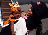 'Sowwy bout my pajamas, but I just got off the PJ': Rihanna introduces her Tigger onesie-clad infant niece to the high-flying world of private jets
