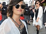 Flirty but edgy! Demi Lovato steps out in New York in ethereal white jacket and black slip dress
