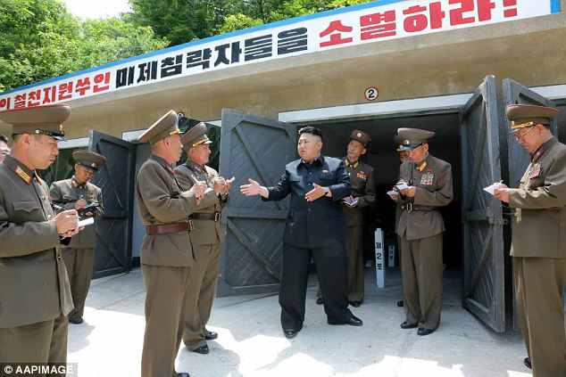 Another inspection: He made the bountiful gesture following an inspection of the Ryo Islet Defense Detachment - a vast military base responsible for protecting the island of Ryodo and the coastal city of Wonsan