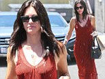 Courteney Cox shows off her svelte figure in red maxidress while out and about in LA