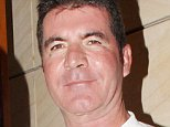 14.AUGUST.2014 - IBIZA - SPAIN *EXCLUSIVE PICTURES* MUSIC MOGUL SIMON COWELL LOOKING PUFFY FACED AS HE LEAVES CIPRIANI RESTAURANT WITH PARTNER LAUREN SILVERMAN IN IBIZA, SPAIN. BYLINE MUST READ : XPOSUREPHOTOS.COM ***UK CLIENTS - PICTURES CONTAINING CHILDREN PLEASE PIXELATE FACE PRIOR TO PUBLICATION *** **UK CLIENTS MUST CALL PRIOR TO TV OR ONLINE USAGE PLEASE TELEPHONE 0208 344 2007**