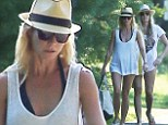 Gwyneth Paltrow wears halter swimsuit in the Hamptons in first sighting since romance rumours with Glee co-creator Brad Falchuk