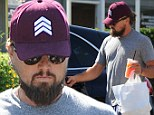 Is there a movie star under there? Leonardo DiCaprio is barely recognisable as he sports an even bushier beard, sunglasses and cap to pick up takeout in LA