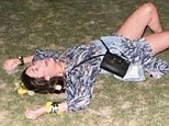 Don't be Shameless! Emmy Rossum gets a fit of the giggles while rolling around the grass in revealing snap