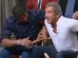 'I've lost weight too!' A burly Mel Gibson breaks his chair while promoting new movie The Expendables 3 and then jumps onto Sylvester Stallone's lap