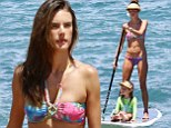 Aloha! Alessandra Ambrosio displays her fantastic figure in rainbow tie-dye bikini as she paddleboards with little Anja in Maui