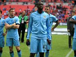 Manchester City's Yaya Toure appears dejected after the Community Shield match at Wembley Stadium, London. PRESS ASSOCIATION Photo. Picture date: Sunday August 10, 2014. See PA story SOCCER Shield. Photo credit should read: Nick Potts/PA Wire. RESTRICTIONS: Editorial use only. Maximum 45 images during a match. No video emulation or promotion as 'live'. No use in games, competitions, merchandise, betting or single club/player services. No use with unofficial audio, video, data, fixtures or club/league logos.