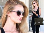 Her usual routine: Rosie Huntington-Whiteley showed how she stays in shape as she left a Ballet Bodies class in West Hollywood on Friday