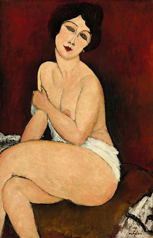 Amedeo Modigliani's Nu assis sur un divan (La Belle Romaine) fetched $68.9 million US in New York Tuesday night, setting a new auction record for the artist.