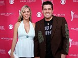Back home: Josh Gracin is back with his family and wife Ann Marie Kovacs after posting an apparent suicide note, pictured in May 2006 at the ACMAs