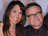 Disease: Robin Williams was battling the early stages of Parkinson's Disease when he took his life, his grieving wife, Susan Schneider, pictured with him in 2003,  revealed today
