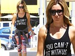 Ashley Tisdale is one 'mean girl' as she sports You Can't Sit With Us tank top on the way to Pilates class
