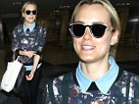 Flower power! Taylor Schilling is a fashionable flyer in a floral print top as she jets out of LAX