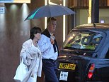 Welcome to the Manchester Weather...... Man United manager Louis van Gaal and his wife Truss walk back in the rain to The Lowry Hotel on Thursday (14.8.14) night after dining at Australasia Restaurant in the Spinningfields area of Manchester city centre.