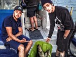 Dish of the day: (L-R) Liam Payne and Zayn Malik enjoy a fishing trip on Saturday while on their American tour