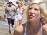 Life's a beach! Tori Spelling and Dean McDermott continue to put on a united front as they spend a day with their children