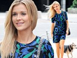 She's covered up! Joanna Krupa flashes toned legs as she dons demure dress during a break from filming Poland's Next Top Model