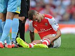 Barclays Premier League, Arsenal v Crystal Palace: Kevin Quigley/Daily Mail/Solo Syndication Jack Wilshere (Arsenal) olding his leg after a tackle by Marouane Chamakh (Crystal Palace)