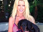 Tara Reid parades around in another tiny bikini as she cuddles up next to a precious pooch in Instagram snap