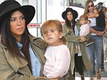 Pregnant Kourtney Kardashian jets out of JFK with children...as Scott Disick stays behind to host boozy poolside party