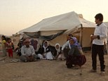 Lucky ones: Islamic State militants today 'massacred' more than 300 Yazidi men - just one day after allegedly killing 82 others who refused to convert to Islam. Above, Yazidis take refuge in Dohuk Province