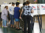 FILE - In this June 6, 2006 file photo, people casting their ballot in the California primary election in Los Angeles. With fewer than a fourth of voters sho...