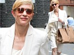 Business chic: The Blue Jasmine star sported a flowing blazer over a matching knee-length dress, teamed with jewel-encrusted flats
