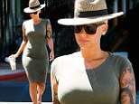 Amber Rose shows off her incredible figure in skin-tight dress as she enjoys some pampering at the salon