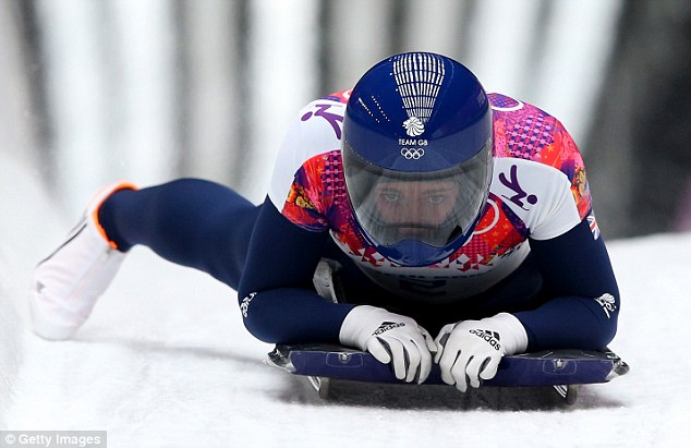 Sliding to success: Yarnold crosses the finish line to win the gold medal in the skeleton bob at the Winter Olympics
