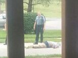 Warning: Graphic Content: Missouri rapper Thee Pharoah shared this disturbing image of Michale Brown lying dead in the middle of the street in Ferguson last Saturday after being shot by a police officer