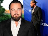 Leonardo DiCaprio ties his long locks back in a bun and sports scruffy beard as special guest at environmental event