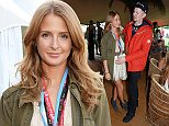 CHELMSFORD, ENGLAND - AUGUST 16:  Millie Mackintosh (L) and Professor Green attend the Mahiki Rum Bar for the launch of the Mahiki Rum Family backstage during day 1 of the V Festival 2014 at Hylands Park on August 16, 2014 in Chelmsford, England. \nPic Credit: Dave Benett