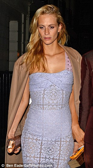 Keeping warm: Suki Waterhouse and Poppy Delevingne put their coats on to venture outside after the party