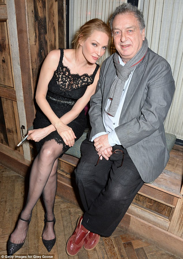 Catching up: Uma and Stephen Frears looked like they were enjoying a good old catch up as they sat down on a wooden bench