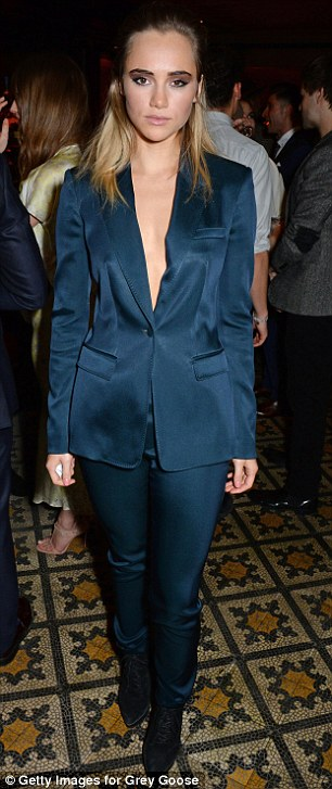 Taking the plunge: Evidently having discussed their sartorial choices prior to arriving at the event, held in partnership with Burberry and Grey Goose Vodka, the girls both opted for rather daring plunging tuxedo jackets and matching cigarette pants