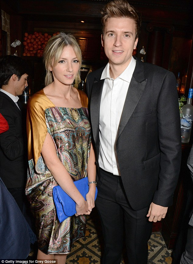 Stylish suit: Radio 1 DJ Greg James looked dapper as he posed with a blonde guest