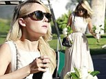 It's nearly her turn! Lauren Conrad is glamorous in a cream gown as she plays bridesmaid for best friend