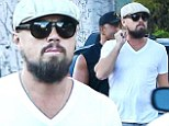 Leonardo DiCaprio goes incognito with cap, sunglasses and scruffy beard as he steps out in Beverly Hills