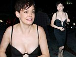 Her cups runneth over! Rose McGowan is every inch the Hollywood sex kitten in a daring low cut dress