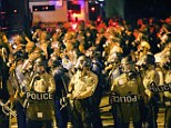 Hordes of riot police advance on protesters in Ferguson, Missouri
