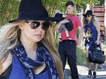 Leading from behind! Fergie lets husband Josh Duhamel walk ahead as they go for stroll in Los Angeles