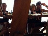 No so happy families: Kendra sat far apart from husband Hank Baskett at a family dinner in Costa Rica