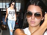 She's ripping it up! Kendall Jenner struts through LAX in shredded skinny jeans en route to Paris
